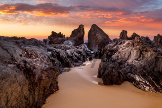 Ocean sunrise with craggy rock channels near Narooma
