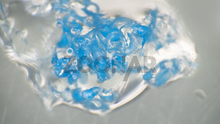 Crushing and agglomeration of plastic particles on water surface.