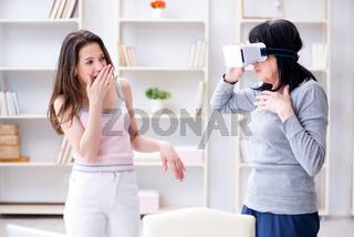 Senior woman experiencing virtual reality glasses