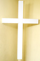 White cross on a white background.