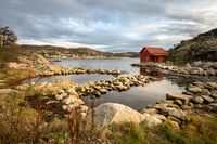 Spangereid, Norway, October 2019: Boat house by the fjord