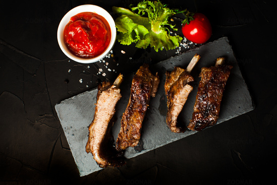 Grilled sliced barbecue pork ribs with sauce