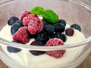 tasty dessert garnish with iced berries - Bilder