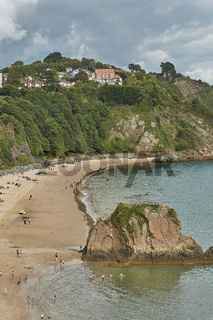 People at the beach in Tenby, Wales, UK.