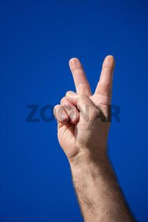 male hand V sign