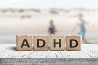 ADHD sign on a wooden table with kids