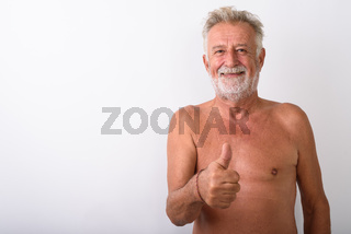 Happy senior bearded man smiling while giving thumbs up