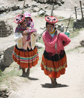 Patachancha, Cuzco, Peru - October 21, 2012 : Smiling Indigenous Women Walking Uphill. One Of Them  Carrying Her Baby In A Sling