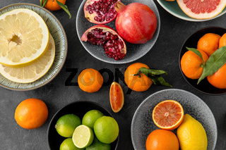 close up of citrus in bowls fruits on stone table