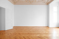 white wall background in empty apartment room , flat with wooden floor and stucco ceiling