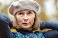 Woman in grey beret