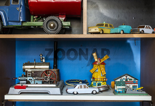 Old vintage toys on shelf.