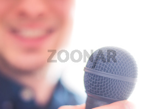 Press officer is speaking into a microphone and giving an interview