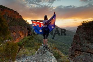 Patriotic woman holding Australian flag in Blue Mountains Australia