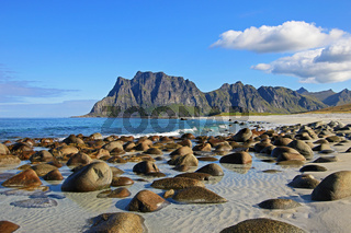 Beautiful pebble beach near Uttakleiv, with mountains in the background, Lofoten Islands, Norway, Europe