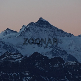 Mount Jungfrau just after sunset, famous mountain in the Bernese Oberland. View from Mount Brienzer Rothorn.
