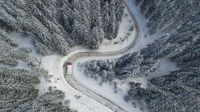Meandering Winter Mountain Road with a Truck