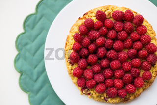 bright raspberry cake on a plate