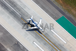Wheels Up Cessna 750 Citation X airplane Los Angeles airport aerial view