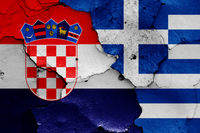 flags of Croatia and Greece painted on cracked wall