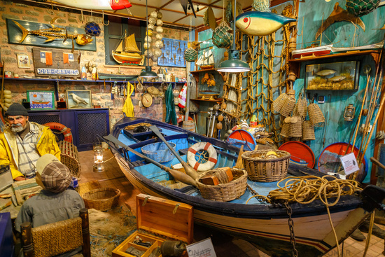 Istanbul, Turkey, 23 March 2019: Fisherman in boathouse with boat, fishing equipment and nets. Composition in the Rahmi M. Koc Industrial Museum
