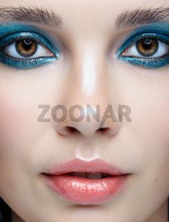 Closeup macro portrait of female face. Woman with evening beauty makeup