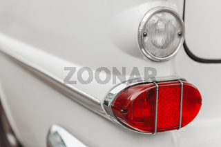 Left tail light white vintage car