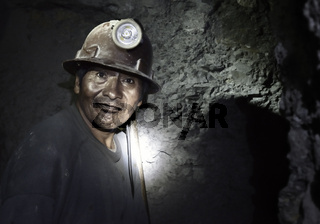 Portrait of a miner inside Cerro Rico silver mine. October 8, 2012 - Potosi, Bolivia