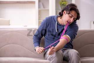 Young man having problems with narcotics at home