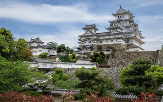 Panoramic view on Himeji Castle Complex on a clear, sunny day inside a green landscape. Himeji, Hyogo, Japan, Asia.