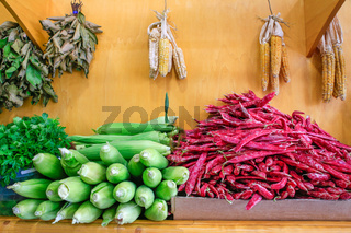 Red Borletto beans and corn cobs on market