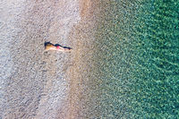 A beautiful woman at the beach Agios Dimitrios of Alonissos from drone, Greece