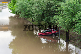 SUV car stuck at roadside by high water near downtown Houston close-up