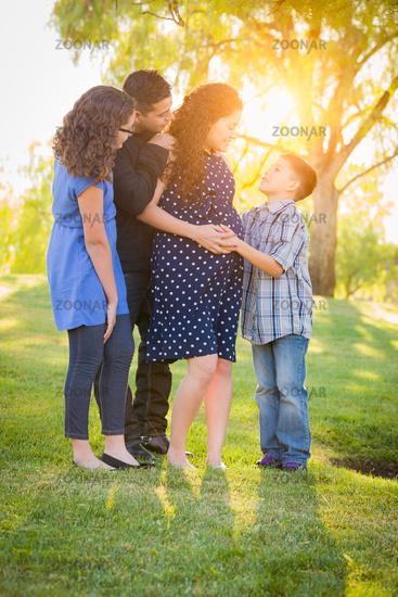 Hispanic Pregnant Family Portrait Outdoors
