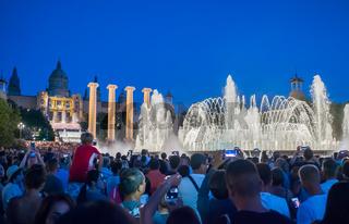 Barcelona, Spain - August 5, 2018: The famous Magic Fountain light show at night. Plaza Espanya in Barcelona, Spain