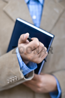 Manager holding agenda and pen at office
