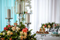 Candles and flowers on festive table