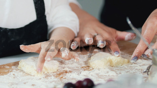 Woman's hands forming homemade pancakes from dough