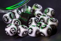 Black and white lottery balls in a machine