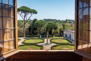Obelisk in formal gardens view from Villa Medici