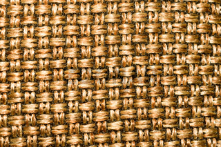 Burlap Sack pattern of Metal gold color for floor design or external wall decoration of a modern building with vibrant shiny material. Can use in fashion, handbags packaging cases or luxury items.