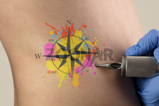 Tattooing traveling concept on naked back