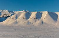 Arctic winter landscape with snow covered mountains on Svalbard, Norway