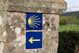 Camino de Santiago tiles on stone wall