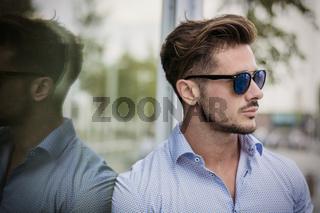 Stylish handsome man wearing elegant shirt outside