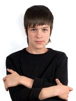 Portrait of serious teenager with arms crossed at chest