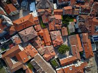Old buildings with red-orange roofs in Kotor in Montenegro