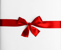 Red ribbon bow isolated on white