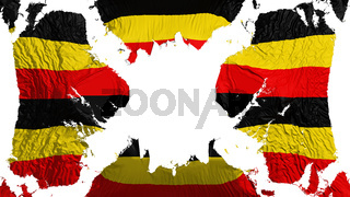 Uganda torn flag fluttering in the wind