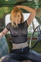 Gorgeous Blonde Model Posing With Wrecked Cars
